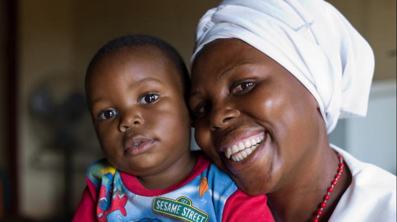A healthy mother and child at a Zambian health care center. Photo Credit - UNICEF Zambia